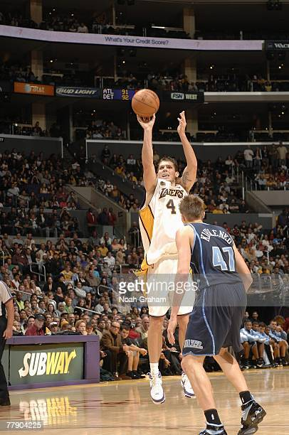 Luke Walton of the Los Angeles Lakers takes a jump shot against Andrei Kirilenko of the Utah Jazz during the game at Staples Center on November 4...