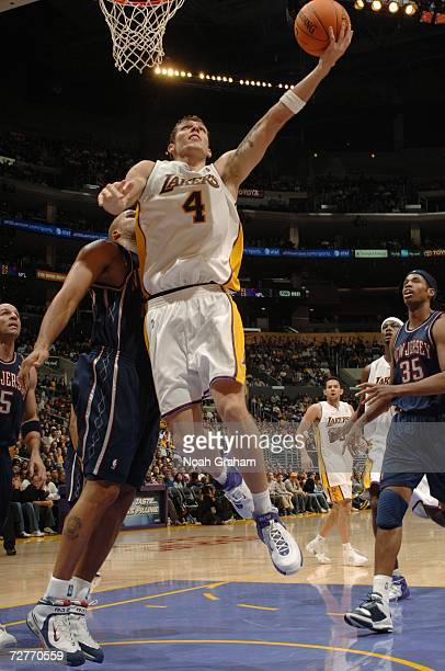 Luke Walton of the Los Angeles Lakers takes the ball to the basket against the New Jersey Nets during the game at Staples Center on November 26 2006...