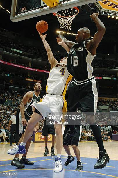 Luke Walton of the Los Angeles Lakers takes the ball to the basket against Francisco Elson of the San Antonio Spurs during the game at Staples Center...