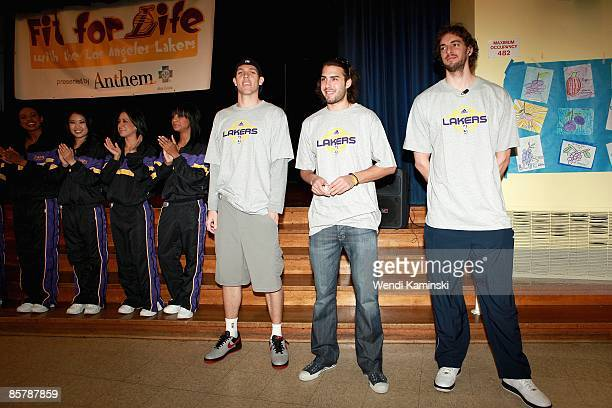 Luke Walton Sasha Vujacic and Pau Gasol of the Los Angeles Lakers and the Laker Girls participate in Anthem Blue Cross's 'Fit for Life' nutrition...