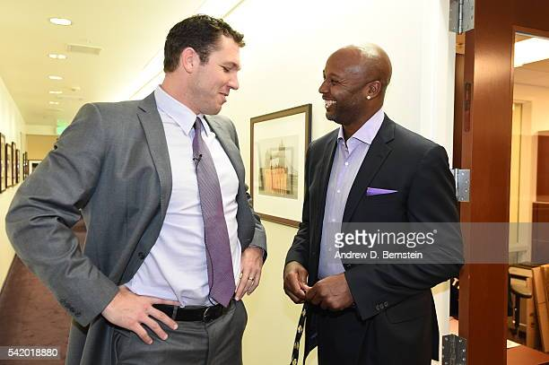 Luke Walton speaks with Brian Shaw after being introduced as head coach of the Los Angeles Lakers on June 21 2016 at Toyota Sports Center in El...