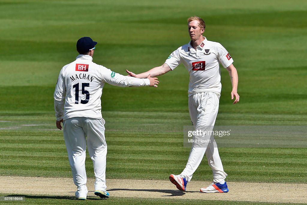 Luke Wells of Sussex is congratulated by team mate Matt Machan after bowling Ben Raine of Leicestershire during the Specsavers County Championship Division Two match between Sussex and Leicestershire on May 03, 2016 in Hove, England.