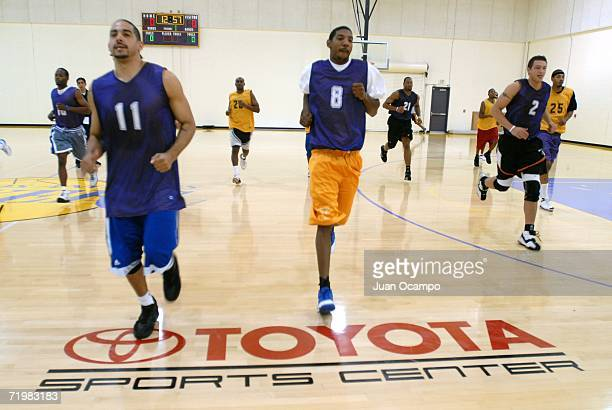 Luke Whitehead and Andre Patterson participate in drills during the NBDL Los Angeles DFenders player tryouts held at the Toyota Training Center...