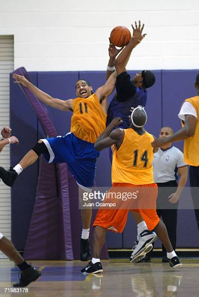 Luke Whitehead battles for the rebound against Rashid Byrd as James Williams looks on during a game at the NBDL Los Angeles DFenders player tryouts...