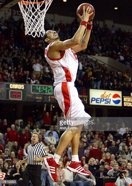 Luke Whitehead of Louisville dunks against Houston on January 28 2004 at Freedom Hall in Louisville Kentucky