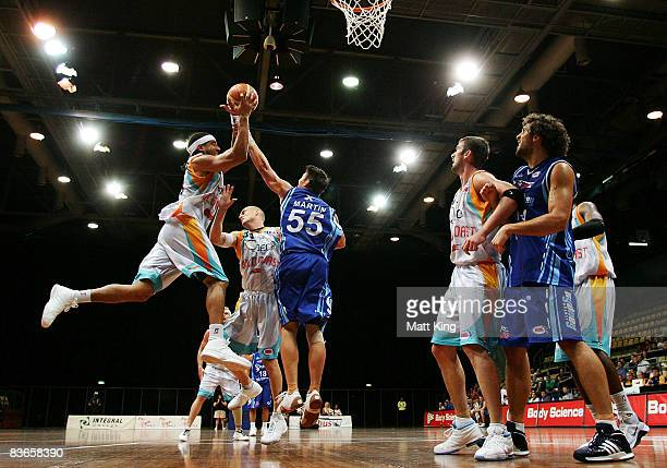 Luke Whitehead of the Blaze and Damian Martin of the Spirit rebound during the round nine NBL match between the Sydney Spirit and the Gold Coast...