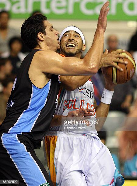 Luke Whitehead of the Blaze clashes with Oscar Foreman of the Breakers during the round five NBL match between the New Zealand Breakers and the Gold...