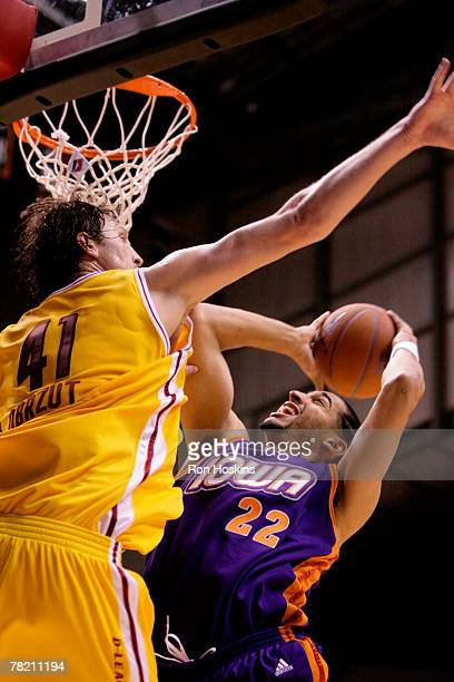 Luke Whitehead of the Iowa Energy shoots over Lukasz Obrzut of the Ft Wayne Mad Ants at Allen County Memorial Coliseum December 2 2007 in Ft Wayne...