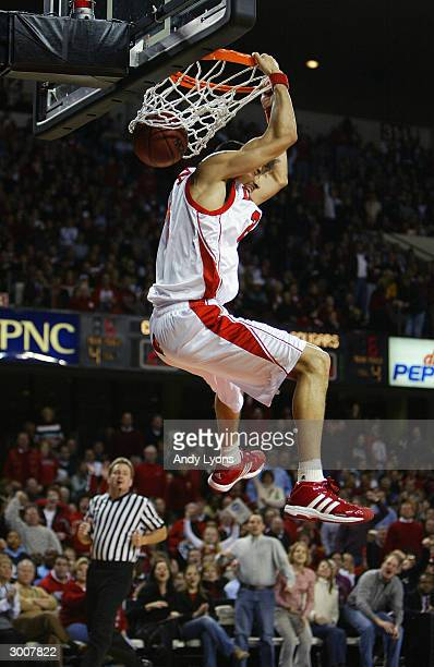 Luke Whitehead of the Louisville Cardinals dunks the ball during the game against the Houston Cougars on January 28 2004 at Freedom Hall in...