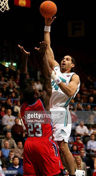 Luke Whitehead of the Sioux Falls Skyforce looks for the short hook against Olu Famutimi of the Arkansas RimRockers during the third quarter of their...