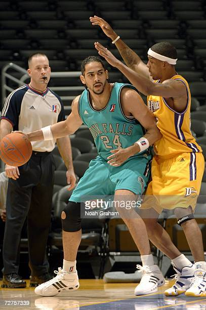 Luke Whitehead of the Sioux Falls Skyforce makes a move to the hoop against Chet Mason of the Los Angeles DFenders on December 6 2006 at Staples...