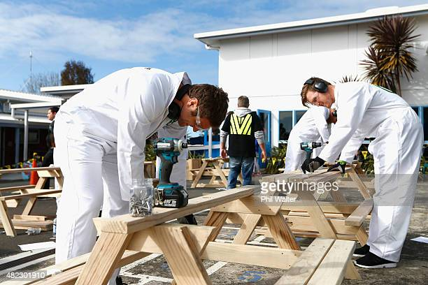 Luke Whitelock of Canterbury and Brendon O'Connor of Hawkes Bay build lunch tables for children at New Windsor School to use during the 2015 ITM Cup...