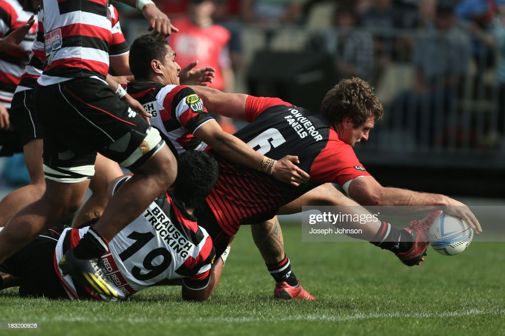 Luke Whitelock of Canterbury scores a try in the tackle of Tyrone Lefau and Seluini Molia of Counties Manukau during the round eight ITM Cup match between Cantebury and Counties Manukau at AMI Stadium on October 6, 2013 in Christchurch, New Zealand.