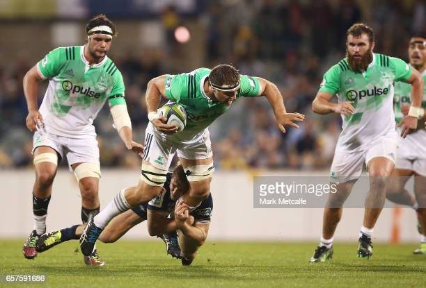 Luke Whitelock of the Highlanders is tackled during the round five Super Rugby match between the Brumbies and the Highlanders at GIO Stadium on March...