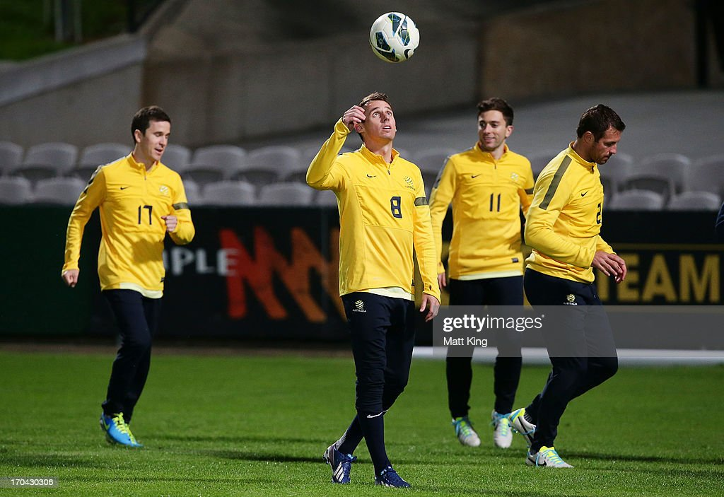 <a gi-track='captionPersonalityLinkClicked' href=/galleries/search?phrase=Luke+Wilkshire&family=editorial&specificpeople=535578 ng-click='$event.stopPropagation()'>Luke Wilkshire</a> (C) controls the ball during an Australian Socceroos training session at WIN Jubilee Stadium on June 13, 2013 in Sydney, Australia.