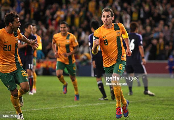 Luke Wilkshire of Australia celebrates after scoring a goal during the FIFA World Cup Asian Qualifier match between the Australian Socceroos and...