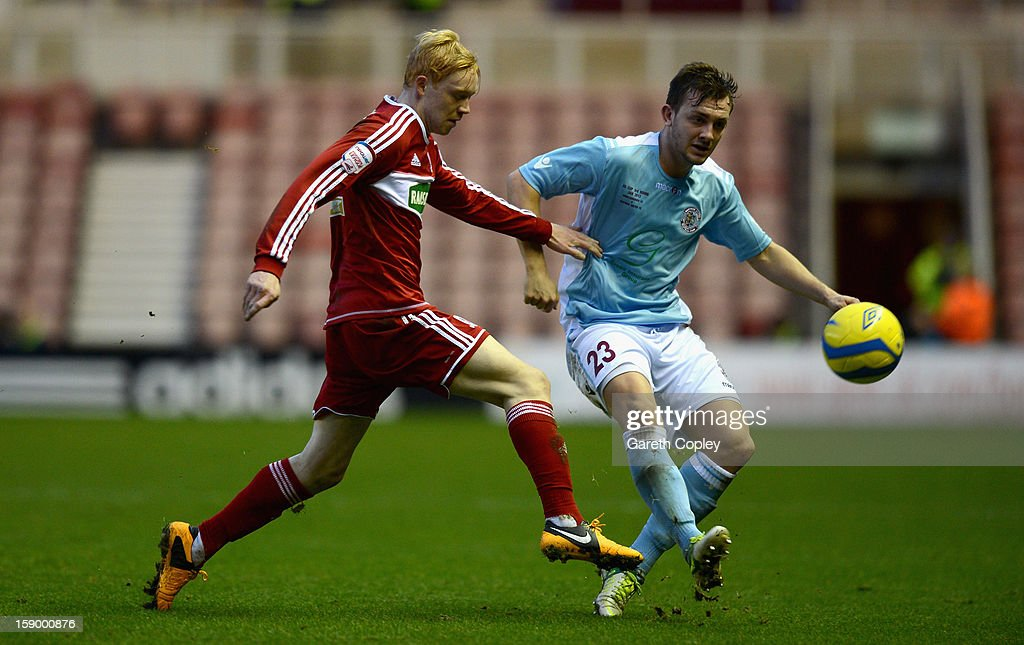 Luke Williams of Middlesborough is tackled by Tom Vickers of Hastings during the FA Cup with Budweiser Third Round match between Middlesbrough and Hastings United at Riverside Stadium on January 5, 2013 in Middlesbrough, England.