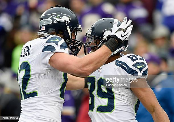 Luke Willson and Doug Baldwin of the Seattle Seahawks celebrate a touchdown against the Minnesota Vikings by Baldwin during the second quarter of the...