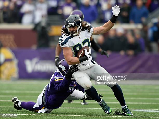 Luke Willson of the Seattle Seahawks avoids a tackle by Sharrif Floyd of the Minnesota Vikings during the first quarter of the game on December 6...