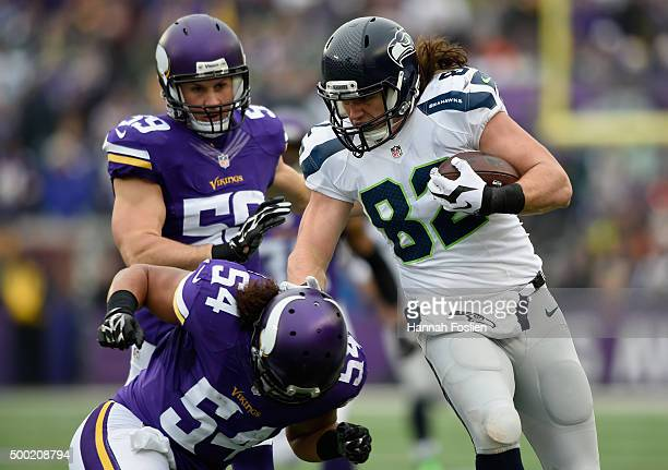 Luke Willson of the Seattle Seahawks carries the ball against Casey Matthews and Eric Kendricks of the Minnesota Vikings during the first quarter of...