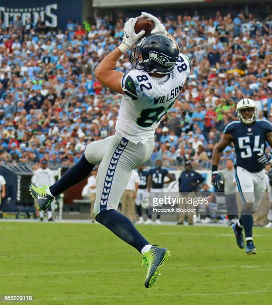 Luke Willson of the Seattle Seahawks catches a touchdown pass against the Tennessee Titans during the second half at Nissan Stadium on September 24...