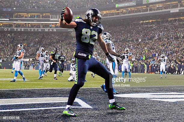 Luke Willson of the Seattle Seahawks celebrates after scoring a 25 yard touchdown in the fourth quarter against the Carolina Panthers during the 2015...