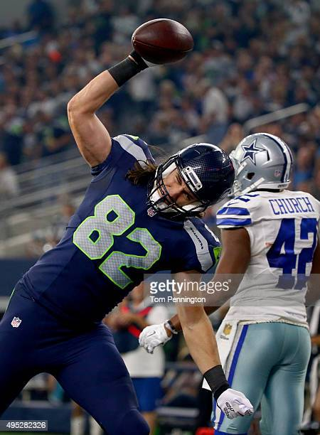 Luke Willson of the Seattle Seahawks celebrates after scoring a touchdown against the Dallas Cowboys at ATT Stadium on November 1 2015 in Arlington...