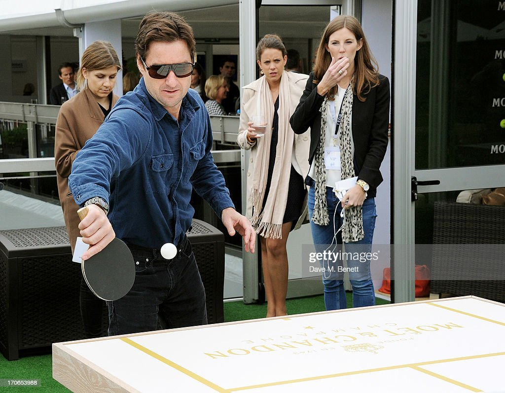 <a gi-track='captionPersonalityLinkClicked' href=/galleries/search?phrase=Luke+Wilson+-+Actor&family=editorial&specificpeople=210582 ng-click='$event.stopPropagation()'>Luke Wilson</a> plays table tennis at The Moet & Chandon Suite at The Aegon Championships Queens Club finals on June 16, 2013 in London, England.