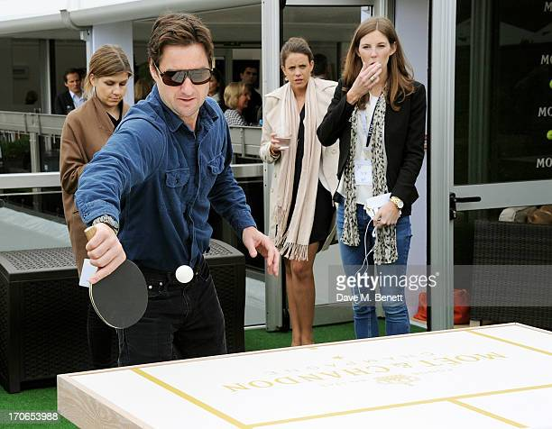 Luke Wilson plays table tennis at The Moet Chandon Suite at The Aegon Championships Queens Club finals on June 16 2013 in London England