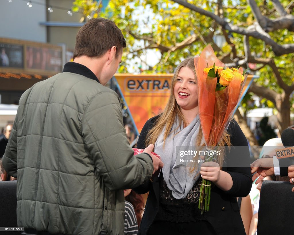 Luke Wilson receives Valentine's Day gifts from a fan at Extra at The Grove on February 14, 2013 in Los Angeles, California.
