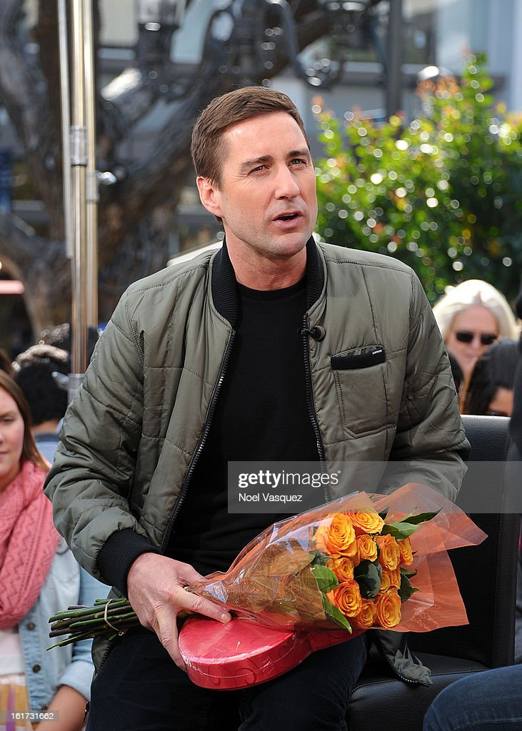 <a gi-track='captionPersonalityLinkClicked' href=/galleries/search?phrase=Luke+Wilson+-+Actor&family=editorial&specificpeople=210582 ng-click='$event.stopPropagation()'>Luke Wilson</a> receives Valentine's Day gifts from a fan at Extra at The Grove on February 14, 2013 in Los Angeles, California.