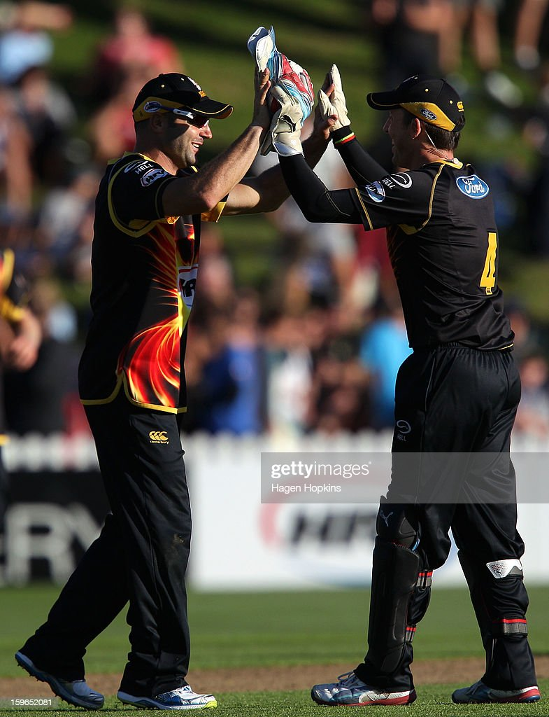 Luke Woodcock (L) and <a gi-track='captionPersonalityLinkClicked' href=/galleries/search?phrase=Luke+Ronchi&family=editorial&specificpeople=724790 ng-click='$event.stopPropagation()'>Luke Ronchi</a> of Wellington celebrate the win at the end of play during the HRV Cup Twenty20 Preliminary Final between the Wellington Firebirds and the Auckland Aces at Basin Reserve on January 18, 2013 in Wellington, New Zealand.