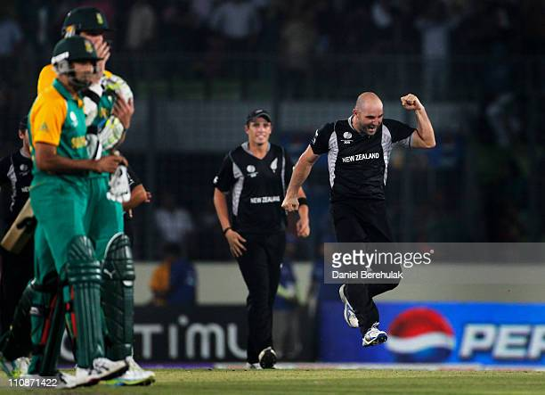 Luke Woodcock of New Zealand celebrates after taking the wicket of Morne Morkel of South Africa to win the game during the 2011 ICC World Cup...