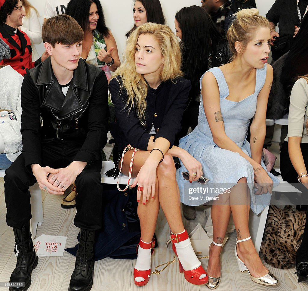 Luke Worrall, Chelsea Leyland and Peaches Geldof attend the Vivienne Westwood Red Label show during London Fashion Week Fall/Winter 2013/14 at the Saatchi Gallery on February 17, 2013 in London, England.