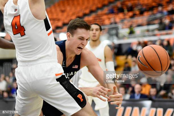 Luke Worthington of the Brigham Young Cougars loses the ball against Mike LeBlanc of the Princeton Tigers during the first half at L Stockwell Jadwin...