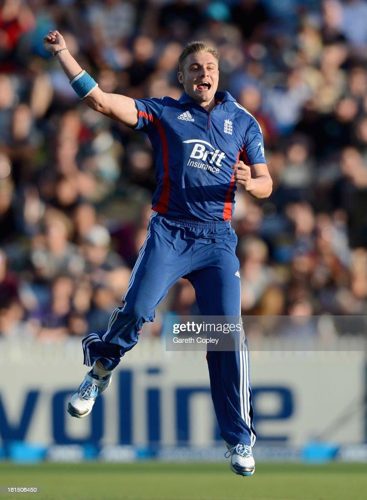 Luke Wright of England celebrates dismissing Hamish Rutherford of New Zealand during the international Twenty20 match between New Zealand and England at Seddon Park on February 12, 2013 in Hamilton, New Zealand.
