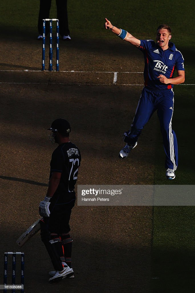 Luke Wright of England celebrates the wicket of <a gi-track='captionPersonalityLinkClicked' href=/galleries/search?phrase=Hamish+Rutherford&family=editorial&specificpeople=4880824 ng-click='$event.stopPropagation()'>Hamish Rutherford</a> of New Zealand during the international Twenty20 match between New Zealand and England at Seddon Park on February 12, 2013 in Hamilton, New Zealand.