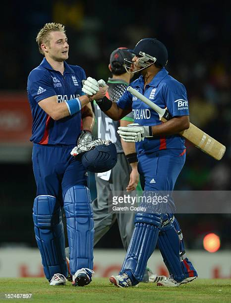 Luke Wright of England is congratulated by teammate Samit Patel after his innings of 99 not out during the ICC World Twenty20 2012 Group A match...