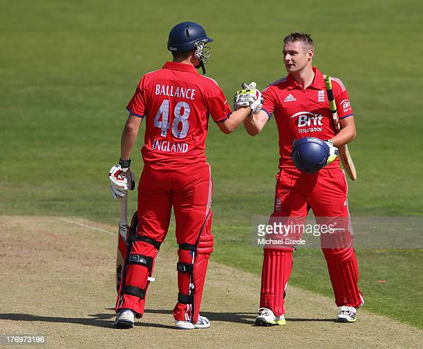 Luke Wright of England Lions is congratulated by Gary Ballance after reaching his century during the One Day International match between England...