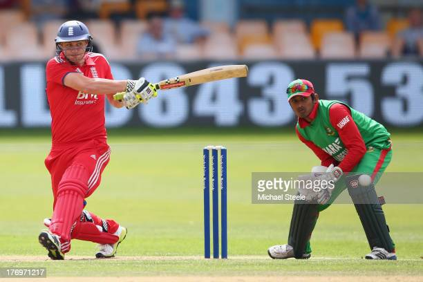 Luke Wright of England Lions pulls a shot to the boundary as wicketkeeper Anamal Haque of Bangladesh A looks on during the One Day International...