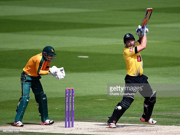 Luke Wright of Sussex hits out as Chris Read looks on for Nottinghamshire during the Royal London OneDay Cup match between Sussex and Nottinghamshire...