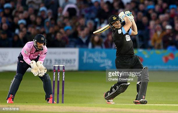 Luke Wright of Sussex hits out while John Simpson of Middlesex looks on during the Natwest T20 Blast match between Sussex and Middlesex at The...