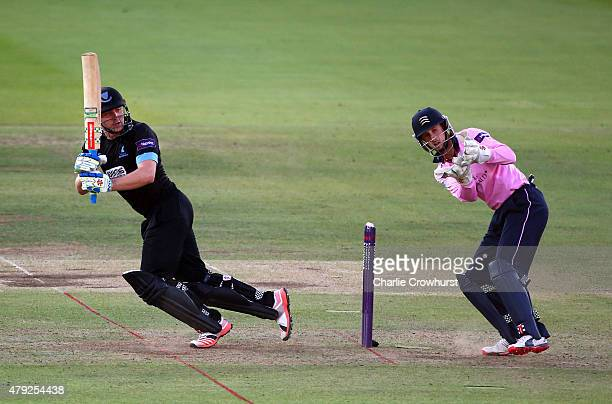 Luke Wright of Sussex hits out while John Simpson of Middlesex looks on during the NatWest T20 Blast match between Middlesex and Sussex at Lord's...