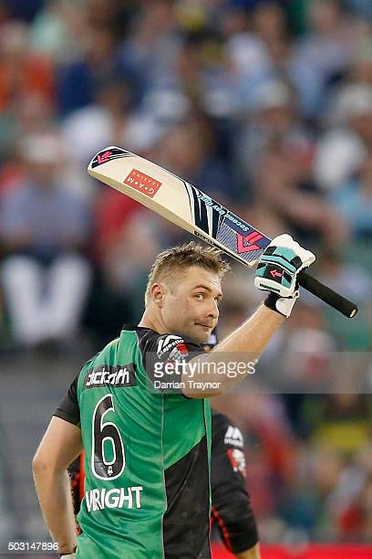 Luke Wright of the Melbourne Stars raises his bat after scoring 50 runs during the Big Bash League match between the Melbourne Stars and the...