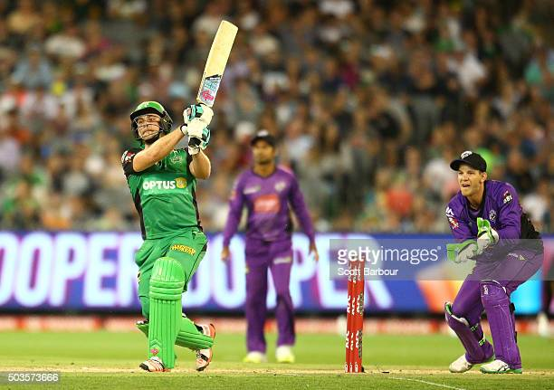 Luke Wright of the Stars bats as wicketkeeper Tim Paine of the Hurricanes looks on during the Big Bash League match between the Melbourne Stars and...