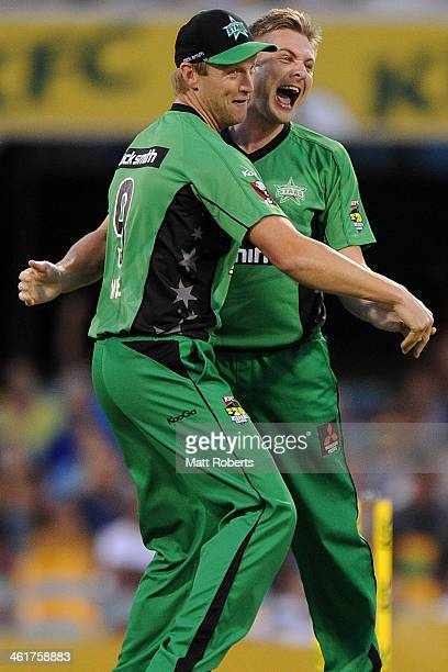 Luke Wright of the Stars celebrates the wicket of Chris Lynn of the Heat with Cameron White during the Big Bash League match between Brisbane Heat...
