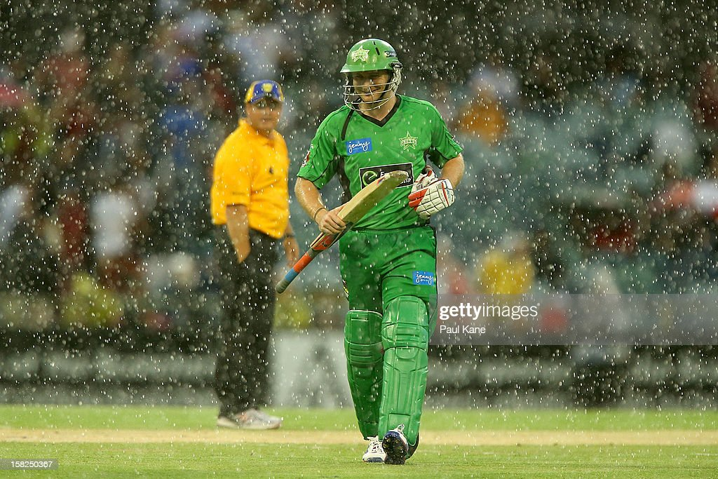 Luke Wright of the Stars heads from the field as heavy rain sets in during the Big Bash League match between the Perth Scorchers and the Melbourne Stars at WACA on December 12, 2012 in Perth, Australia.