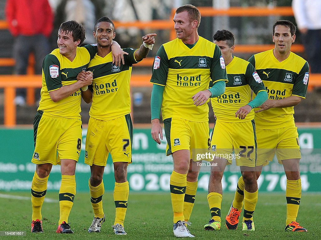 <a gi-track='captionPersonalityLinkClicked' href=/galleries/search?phrase=Luke+Young&family=editorial&specificpeople=167268 ng-click='$event.stopPropagation()'>Luke Young</a> of Plymouth Argyle (L) celebrates his goal with Paris Cowan-Hall (2nd L) during the npower League Two match between Barnet and Plymouth Argyle at Underhill Stadium on October 13, 2012 in Barnet, England.