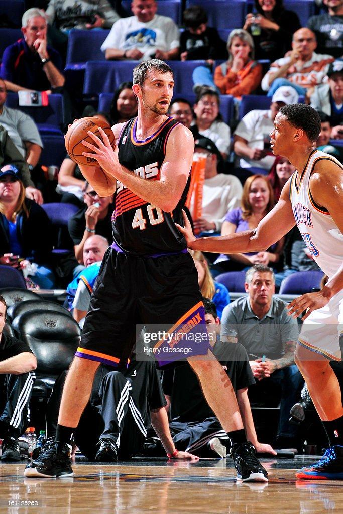 Luke Zeller #40 of the Phoenix Suns controls the ball against Daniel Orton #33 of the Oklahoma City Thunder on February 10, 2013 at U.S. Airways Center in Phoenix, Arizona.