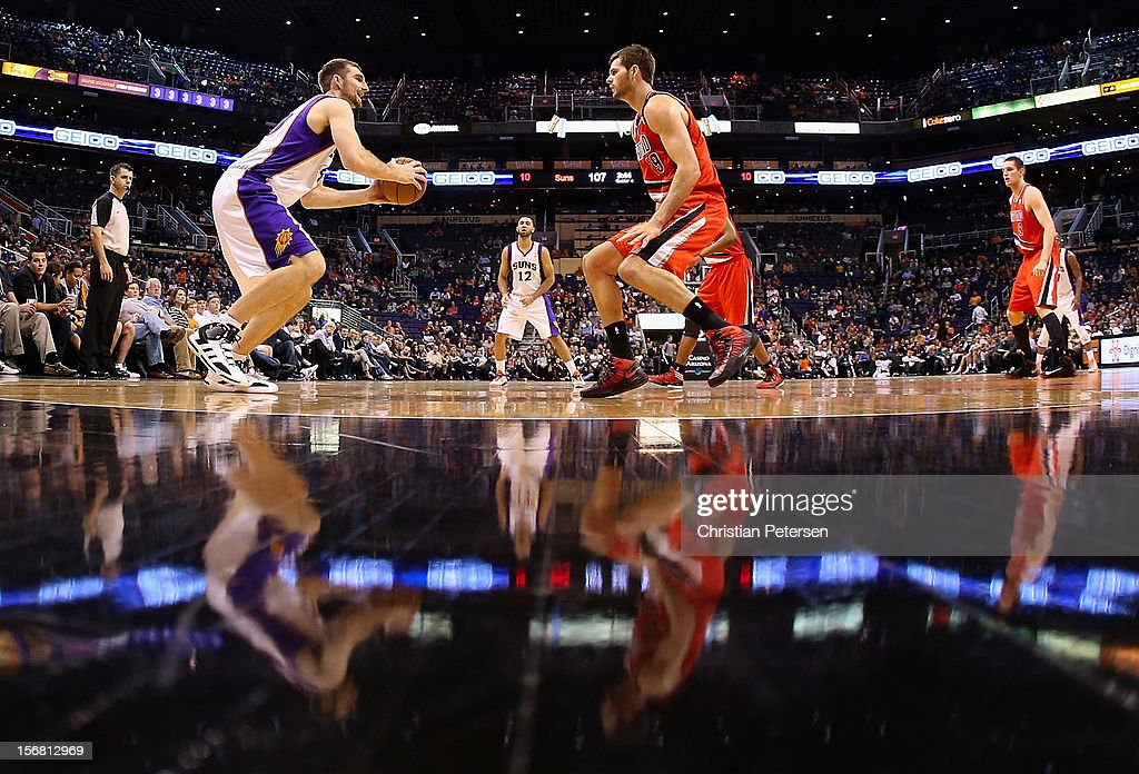 <a gi-track='captionPersonalityLinkClicked' href=/galleries/search?phrase=Luke+Zeller&family=editorial&specificpeople=4057826 ng-click='$event.stopPropagation()'>Luke Zeller</a> #40 of the Phoenix Suns looks to shoot guarded by <a gi-track='captionPersonalityLinkClicked' href=/galleries/search?phrase=Elliot+Williams&family=editorial&specificpeople=5042444 ng-click='$event.stopPropagation()'>Elliot Williams</a> #9 of the Portland Trail Blazers during the NBA game at US Airways Center on November 21, 2012 in Phoenix, Arizona. The Suns defeated the Trail Blazers 114-87.